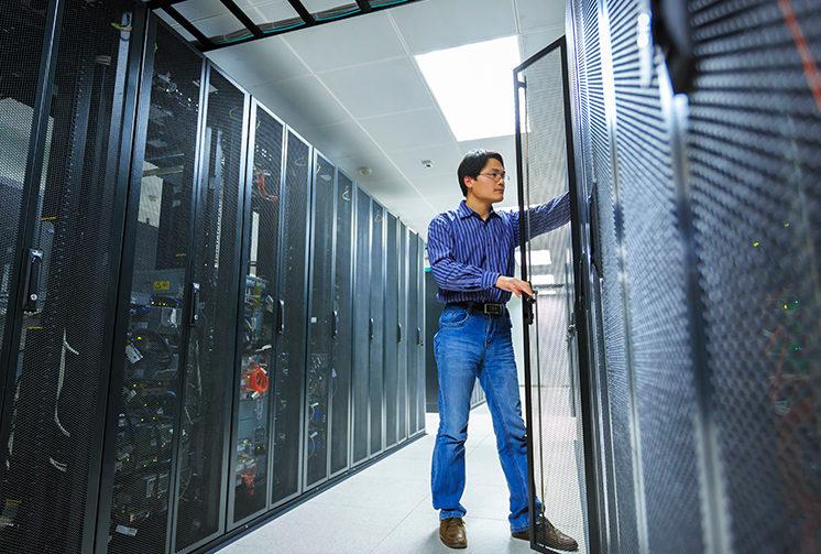 Man assesses server performance