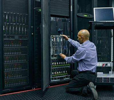 Man performs maintenance on IT equipment
